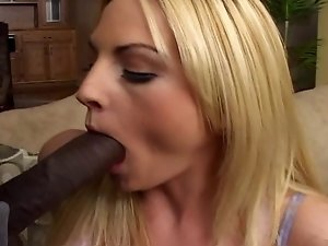Blonde chick sucking black dick and licking balls