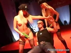Two blonde strippers on stage get fucked by a big hard cock