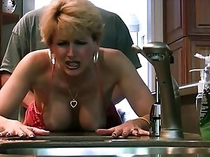 Alluring Cougar gets hard cock in the kitchen